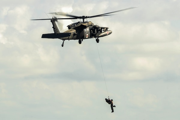 U.S. Army Staff Sgt. Jun Ma, a flight paramedic assigned to the 1st Battalion, 228th Aviation Regiment, utilizes a hoist from a UH-60L Black Hawk to extract a role player acting as a patient during an open water hoist training scenario off the coast of Belize District, July 21, 2016. Typical missions conducted by Joint Task Force-Bravo's 1-228th AVN include counter-drug operation support and training, disaster relief, humanitarian assistance, air movement of people, equipment and supplies, aeromedical evacuation, and search and rescue.  (U.S. Air Force photo by Staff Sgt. Siuta B. Ika)