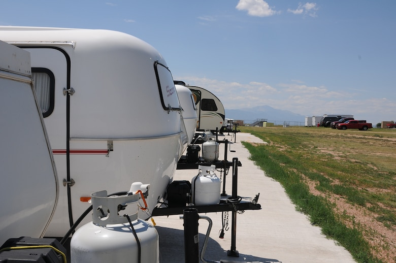 A row of recreational vehicles for rent are parked outside the Outdoor Recreational Warehouse at Schriever Air Force Base, Colorado, Monday, Aug. 1, 2016. The vehicles can be stored by any base personnel for future use. To store an RV, an appointment must be scheduled through the Information, Tickets and Travel Office in Building 300, room 133. To reach the office call 567-6050. (U.S. Air Force photo/Airman William Tracy)