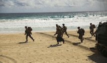 U.S. Marines with Company E, Battalion Landing Team 2nd Battalion, 3rd Marine Regiment, assault a beach during Rim of the Pacific 2016. The assault was launched from USS San Diego and commanded by III Marine Expeditionary Force units aboard USS America. Twenty-six nations, more than 40 ships and submarines, more than 200 aircraft and 25,000 personnel are participating in RIMPAC from June 30 to Aug. 4, in and around the Hawaiian Islands and Southern California. The world's largest international maritime exercise, RIMPAC provides a unique training opportunity that helps participants foster and sustain the cooperative relationships that are critical to ensuring the safety of sea lanes and security in the world's oceans. RIMPAC 2016 is the 25th exercise in the series that began in 1971.