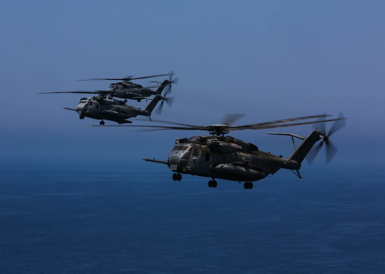 Marine Heavy Helicopter Squadron (HMH) 462 flies over the ocean after returning from a training exercise on Marine Corps Base Camp Pendleton, Calif., July 28. Marine Heavy Helicopter Squadron (HMH) 462 and the Royal Canadian Air Force supported 3rd Battalion, 1st Marine Regiment during Rim of the Pacific (RIMPAC) 2016. (U.S. Marine Corps Photo by Lance Cpl. Harley Robinson/Released)