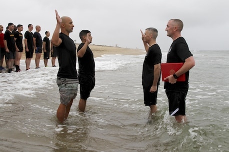 Marines with Marine Corps Recruiting Station Orange County stormed Huntington State Beach June 10, 2016 for a beach run. The purpose of the approximately four mile physical training session was to build morale, camaraderie and to conduct a reenlistment ceremony in the water for Gunnery Sgt. Kevin Aguilar and Sgt. Victor Galvan, both canvassing recruiters with RS Orange County. (U.S. Marine Corps photo by Sgt. Vanessa Jimenez)
