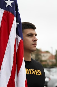 Sergeant Michael Losey, a canvassing recruiter at Recruiting Substation Mission Viejo, stands with the American Flag before a beach run at Huntington State Beach June 10, 2016. The purpose of the approximately four mile physical training session was to build morale, camaraderie and to conduct a reenlistment ceremony in the water for Gunnery Sgt. Kevin Aguilar and Sgt. Victor Galvan, both canvassing recruiters with Marine Corps Recruiting Station Orange County. (U.S. Marine Corps photo by Sgt. Vanessa Jimenez)