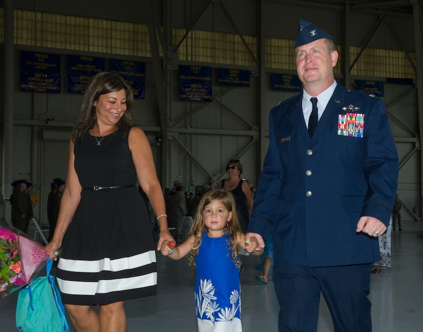 Col. Louis Hansen, right, 437th Operations Group (OG) commander, walks with his wife, Liz and their daughter, B'ella in Nose Dock 2, Joint Base Charleston – AB, Charleston, SC,  on Aug. 2, 2016. Hansen had just assumed command of the 437th OG. (U.S. Air Force photo by Airman 1st Class Thomas T. Charlton)