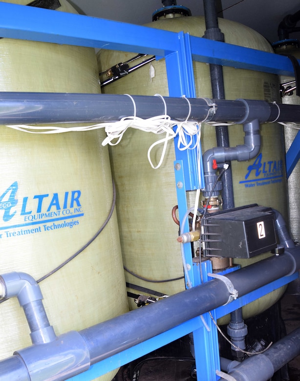 Tucked away in an unassuming 20-foot trailer, a labyrinth of pipes, valves, pumps and gauges feed four enormous fiberglass wrapped granular activated carbon filter cylinders at the Horsham Air Guard Station water treatment facility. Installed and operating on June 30, 2016, the filters will act to scrub perfluorooctane sulfonate and perfluorooctanoic acids from the ground water that supplies the base's water needs. Initial test results as to the levels of the PFCs in the water supply after installation are pending. (U.S. Air National Guard photo by Master Sgt. Christopher Botzum)