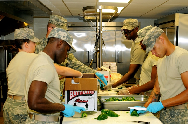A nine-member team composed of Airmen and soldiers from across the Pennsylvania National Guard conduct line preparation and progressive cooking before a dinner for approximately 220 Guardsmen at Fort Indiantown Gap (FITG), Pa., July 25, 2016. The soldiers and Airmen are at FITG to support the National Guard's diversified mission during the Democratic National Convention in Philadelphia. (U.S. Air National Guard photo by Staff Sgt. Michael Shaffer)