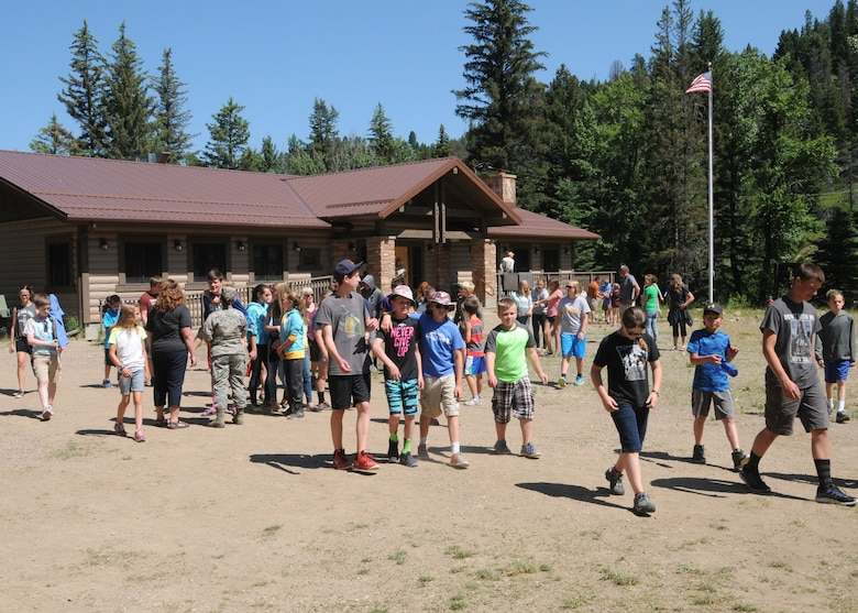 Kids leave the main lodge to gather together at the pavilion area in anticipation for a visit to Camp Runnamucka by the Adjutant General of Montana Maj. Gen. Matthew Quinn June 29, 2016. The week-long camp is designed for children of Montana National Guard children whose parents have deployed or will soon deploy. Camp Runnamucka is held each year at Camp Rotary located near Monarch, Mont. (U.S. Air National Guard photo by Senior Master Sgt. Eric Peterson)