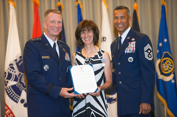 Nancy Dolan, wife of former USFJ Commander Lt. Gen. John Dolan, receives the Commander's Public Service Award for her contributions toward improving morale and quality of life for military families throughout Japan,