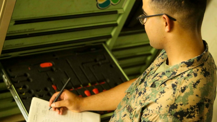 OKINAWA, JAPAN - Cpl. Misaeo Miranda, a motor transportation mechanic with III Marine Expeditionary Force Headquarters Group, conducts an inventory of various tools used by mechanics in his shop, Aug. 3, 2016. When vehicles break down, the Marine Corps relies solely on motor transportation mechanics to fix them. The various exercises that III MEF takes part in puts Marines to the test and prepares them for any crisis that might occur in the Pacific. Miranda is from Naples, Florida. (U.S. Marine Corps photo by Lance Cpl. Nathaniel Cray/ Released)