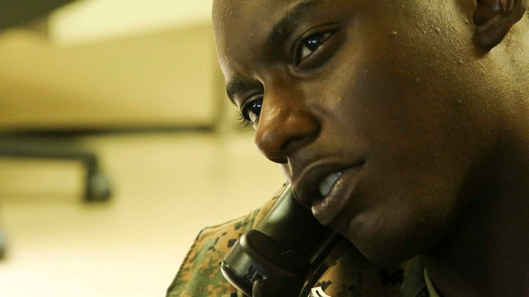 OKINAWA, JAPAN - Cpl. Imani Golden, an embarkation specialist with III Marine Expeditionary Force Headquarters Group, arranges flights for Marines Aug. 3, 2016. Embarkation specialists handle all logistics coordination when Marines travel to different countries. The forward nature of III MEF is crucial to readiness in the Pacific. Golden is from Brooklyn, New York. (U.S. Marine Corps photo by Lance Cpl. Nathaniel Cray/ Released)