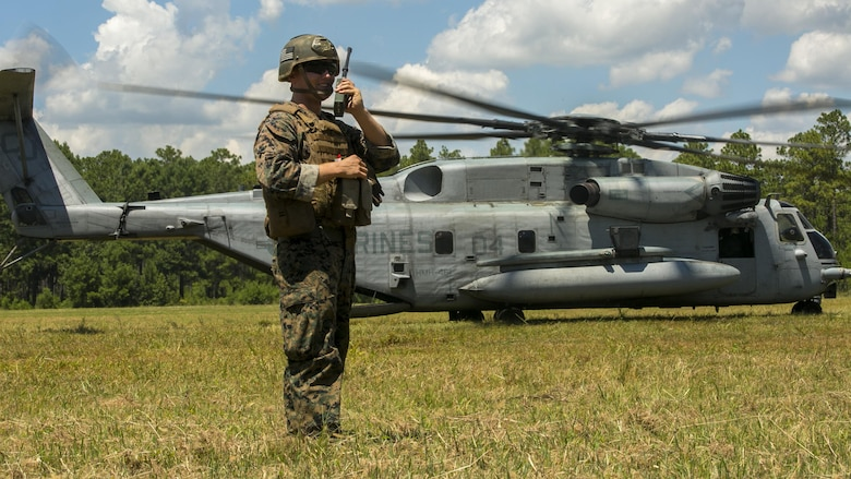 Cpl. Robert Blakeslee, an electric equipment repair specialist with 2nd Air Naval Gunfire Liaison Company, directs a CH-53E Super Stallion where to land July 28, 2016 during a troop lift exercise at Marine Corps Air Station New River. The CH-53E Super Stallion is the largest helicopter in the United States military, and able to carry a 26,000-pound Light Armored Vehicle, 16 tons of cargo, or enough combat-loaded Marines to lead an assault or humanitarian operation. The capabilities provided by the CH-53E strengthen the expeditionary capabilities of Marines Corps units and make this aircraft one of the most useful in the Marine Corps. The CH-53E is attached to Marine Heavy Helicopter Squadron 461, Marine Aircraft Group 29, 2nd Marine Aircraft Wing. ANGLICO is part of the II Marine Expeditionary Force Headquarters Group.
