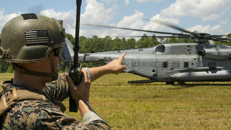 Cpl. Robert Blakeslee, an electric equipment repair specialist with 2nd Air Naval Gunfire Liaison Company, coordinates with the pilot of a CH-53E Super Stallion July 28, 2016 during a troop lift exercise at Marine Corps Air Station New River. The CH-53E Super Stallion is the largest helicopter in the United States military, and able to carry a 26,000-pound Light Armored Vehicle, 16 tons of cargo, or enough combat-loaded Marines to lead an assault or humanitarian operation. The capabilities provided by the CH-53E strengthen the expeditionary capabilities of Marines Corps units and make this aircraft one of the most useful in the Marine Corps. The CH-53E and pilot are assigned to Marine Heavy Helicopter Squadron 461, Marine Aircraft Group 29, 2nd Marine Aircraft Wing. ANGLICO is part of the II Marine Expeditionary Force Headquarters Group.
