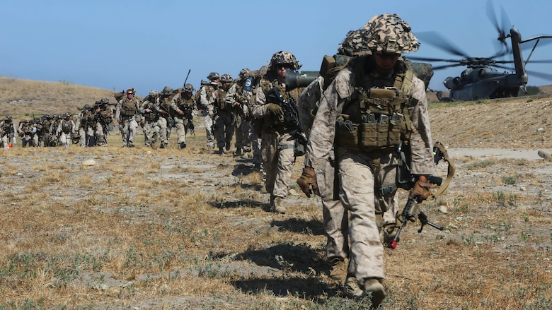 Marines with 3rd Battalion, 1st Marine Regiment line up to board an aircraft during a training exercise, aboard Marine Corps Base Camp Pendleton, Calif., July 28. Marine Heavy Helicopter Squadron (HMH) 462 and the Royal Canadian Air Force supported 3rd Battalion, 1st Marine Regiment during Rim of the Pacific (RIMPAC) 2016.
