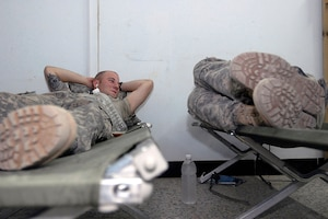 Soldiers with the 2nd Infantry Division rest on military cots during their deployment in support of Operation Iraqi Freedom in June 2010. DLA Troop Support's Construction and Equipment supply chain provides military cots for warfighters and for disaster relief operations, and sent 400 to Alaska for use during a training exercise this summer.