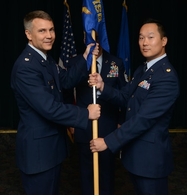 Maj. William Chang, right, 47th Contracting Flight commander, poses for a photo with Lt. Col. Dwayne Gray, 47th Mission Support Group deputy commander, during a change of command at Laughlin Air Force Base, Texas, July 19, 2016. Chang came to Laughlin from his previous position as the Chief of the Directorate of Contracting, Space and Missile Systems Center, Los Angeles Air Force Base, California. (U.S. Air Force photo/Airman 1st Class Brandon May)