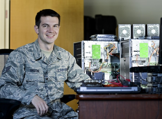 U.S. Air Force Staff Sgt. Sam M. Greene, 325th Communications Squadron client systems supervisor, sits next to network computers at Tyndall Air Force Base, Fla., Aug. 3, 2016. Greene leads a small team of Airmen responsible for installing and maintaining computer hardware, software and a new base-wide voice over internet protocol phone service. (U.S. Air Force photo by Tech. Sgt. Javier Cruz Jr./Released)