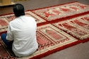A man sits in prayer before the first Muslim religious service offered on Maxwell Air Force Base, Ala., July 29, 2016. The Muslim worship service will take place every other Friday beginning Aug. 5, at 12:30 p.m. and is open to all individuals with base access. (U.S. Air Force photo/Senior Airman Tammie Ramsouer)