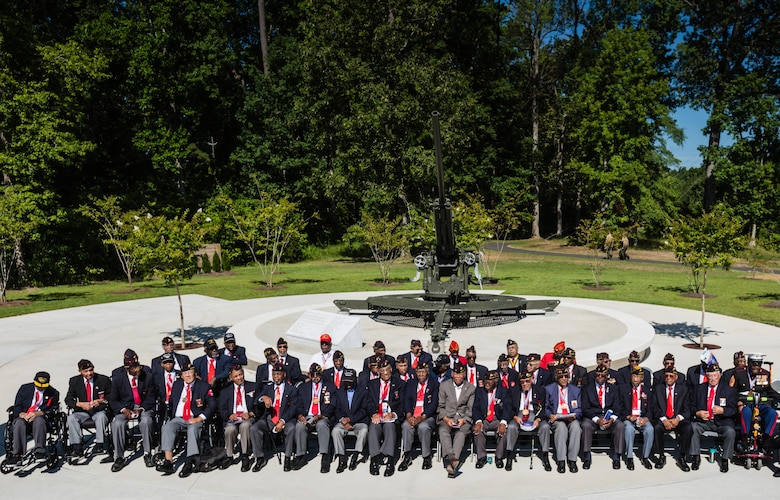 Montford Point Marines assemble for a group photo in front of the M1A1 anti-aircraft gun at the Montford Point Marine Memorial Dedication at Marine Corps Base Camp Lejeune July 29. Hundreds of attendees, including Montford Point Marines, family members, active duty servicemembers and supporters, gathered to attend the memorial dedication which honored the 20,000 segregated African-American Marines who trained there in the 1940s. (U.S. Marine Corps photo by Lance Cpl. Sean J. Berry/Released)