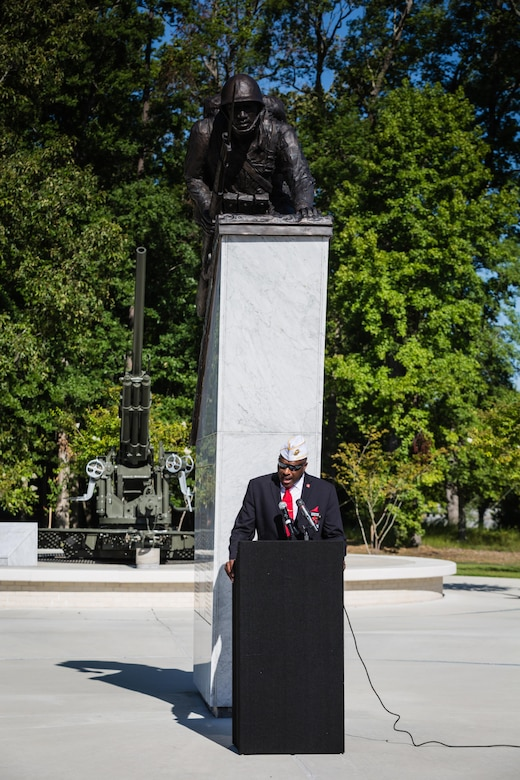 Forest E. Spencer, Jr., National President of the Montford Point Marine Association, delivers the closing remarks at the Montford Point Marine Memorial Dedication at Marine Corps Base Camp Lejeune July 29. Hundreds of attendees, including Montford Point Marines, family members, active duty servicemembers and supporters, gathered to attend the memorial dedication which honored the 20,000 segregated African-American Marines who trained there in the 1940s. (U.S. Marine Corps photo by Lance Cpl. Sean J. Berry/Released)