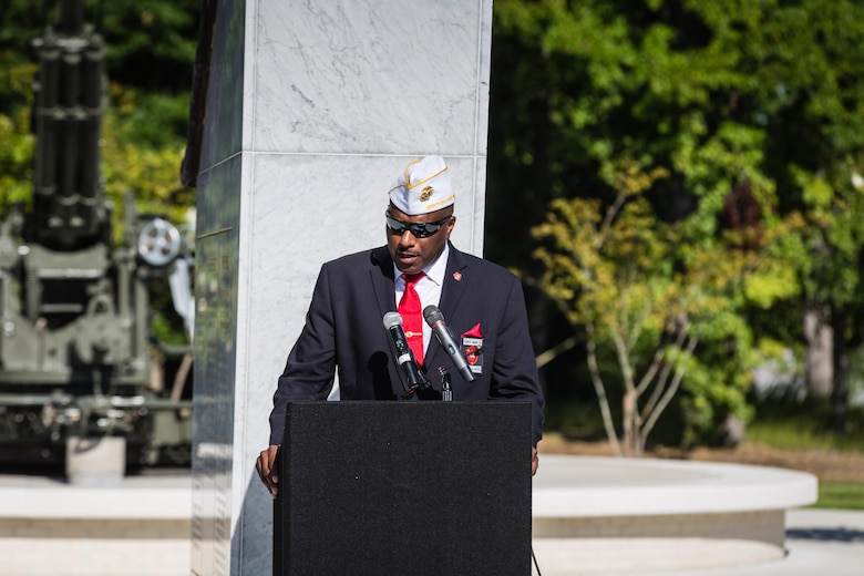 Forest E. Spencer, Jr., National President of the Montford Point Marine Association, delivers remarks at the Montford Point Marine Memorial Dedication at Marine Corps Base Camp Lejeune July 29. Hundreds of attendees, including Montford Point Marines, family members, active duty servicemembers and supporters, gathered to attend the memorial dedication which honored the 20,000 segregated African-American Marines who trained there in the 1940s. (U.S. Marine Corps photo by Lance Cpl. Sean J. Berry/Released)