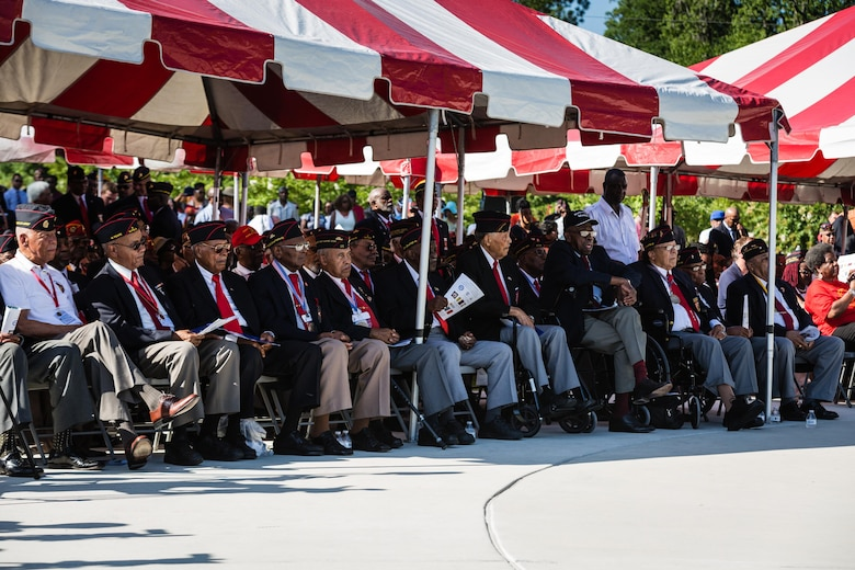 Marines with the National Montford Point Marine Association attend the Montford Point Marine Memorial Dedication at Marine Corps Base Camp Lejeune July 29. Hundreds of attendees, including Montford Point Marines, family members, active duty servicemembers and supporters, gathered to attend the memorial dedication which honored the 20,000 segregated African-American Marines who trained there in the 1940s. (U.S. Marine Corps photo by Lance Cpl. Sean J. Berry/Released)