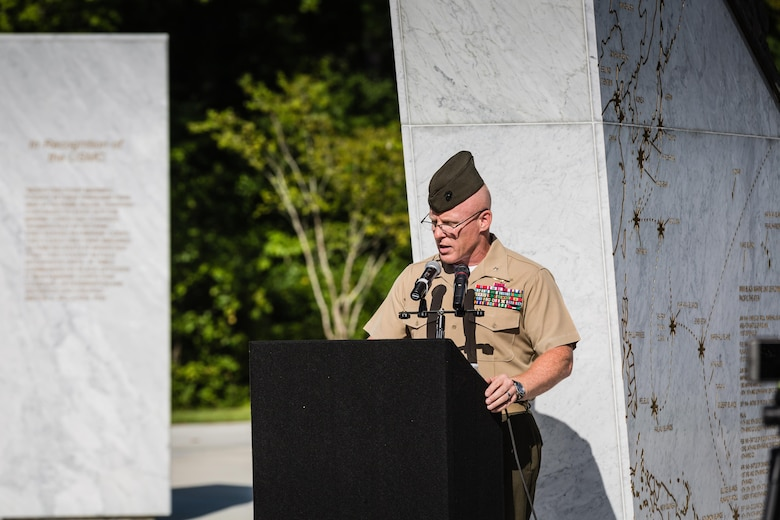 Brig. Gen. Thomas D. Weidley, Marine Corps Installations East – Marine Corps Base Camp Lejeune commanding general, welcomes the community to the Montford Point Marine Memorial Dedication at Marine Corps Base Camp Lejeune July 29. Hundreds of attendees, including Montford Point Marines, family members, active duty servicemembers and supporters, gathered to attend the memorial dedication which honored the 20,000 segregated African-American Marines who trained there in the 1940s. (U.S. Marine Corps photo by Lance Cpl. Sean J. Berry/Released)
