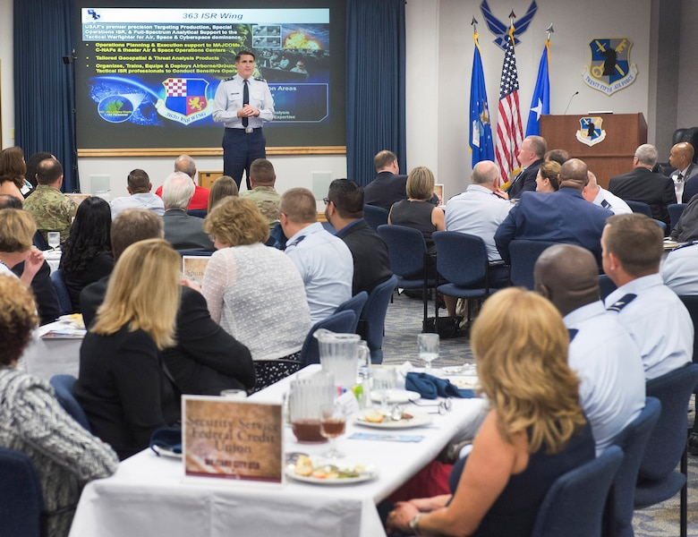 "Maj. Gen Bradford ""BJ"" Shwedo, Commander of the 25th Air Force, JBSA-Lackland, San Antonio, Texas, briefs members of the San Antonio Chamber of Commerce on the world wide mission of the unit in the headquarters auditorium Friday."