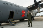 Air Force Lt. Col. Luke Thompson, with the Air Force Reserve Command's 302nd Airlift Wing, stands in front of a C-130 Hercules aircraft at Peterson Air Force Base, Colo., which is equipped with a Modular Airborne Fire Fighting System, July 26, 2016. DoD photo by Lisa Ferdinando