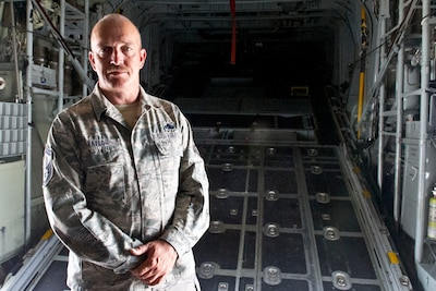 Air Force Senior Master Sgt. Tye Taylor is a maintenance flight chief with the 302nd Airlift Wing and assigned to work on C-130 Hercules aircraft at Peterson Air Force Base, Colo., which are equipped with Modular Airborne Fire Fighting Systems, July 26, 2016. DoD photo by Lisa Ferdinando