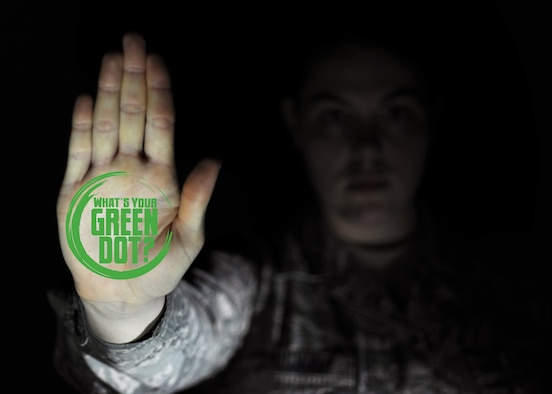 """Grand Forks Air Force Base, N.D. launched the Green Dot Program April 27, 2016. The program focuses on positive actions referred to as """"green dots"""" to help prevent sexual assault, stalking, bullying, domestic violence and more, referred to as """"red dots."""" Airmen will receive training on how to implement this program. (U.S. Air Force graphic by Airman 1st Class Ryan Sparks/Released)"""