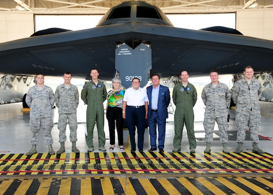 Retired U.S. Air Force Lt. Col. Robert Fortney, center, a former 13th Bomb Squadron (BS) commander, and his family tour the B-2 Spirit during their visit with Lt. Col. Matthew Newell, third from right, the current 13th BS commander, and fellow Team Whiteman members at Whiteman Air Force Base (AFB), Mo., July 26, 2016. During the Cuban Missile Crisis, Fortney was chief of the control division at Barksdale AFB, La. He later transferred to Andersen AFB, Guam as the vice commander from June 1966 through July 1968. While at Andersen, he flew numerous B-52 Stratofortress missions over Vietnam. In 1968, he served as base commander of Blytheville AFB, Ark., until his retirement in June 1971. (U.S Air Force photo by Airman 1st Class Jazmin Smith)
