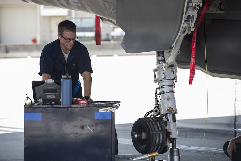 Staff Sgt. Joshua Davlin, 58th Aircraft Maintenance Unit crew chief, services an F-35A wheel Aug. 2, 2016, at Eglin Air Force Base, Fla. During the Aug. 1-3 sortie surge 58th AMU Airmen kept up with the high-tempo demand to provide safe and reliable aircraft for 111 sorties. (U.S. Air Force photo by Senior Airman Stormy Archer)