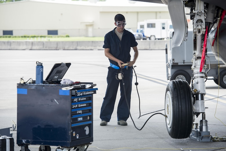 Airman Travis Boyle, 33rd Aircraft Maintenance Unit crew chief, services an F-35A wheel Aug. 2, 2016, at Eglin Air Force Base, Fla. During the Aug. 1-3 sortie surge 58th AMU Airmen kept up with the high-tempo demand to provide safe and reliable aircraft for 111 sorties. (U.S. Air Force photo by Senior Airman Stormy Archer)