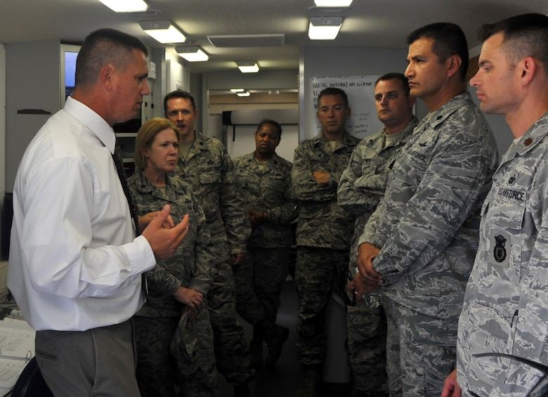 Eric A. Mueller, 460th Civil Engineer Squadron emergency manager, demonstrates the capabilities of Buckley's Mobile Emergency Operations Center to students of the EOC Director Course Aug. 2, 2016 at Buckley Air Force Base, Colo. Buckley's Mobile EOC makes operations easily conductible during any emergency depite location. (U.S. Air Force photo by Airman Holden S. Faul/ Released)