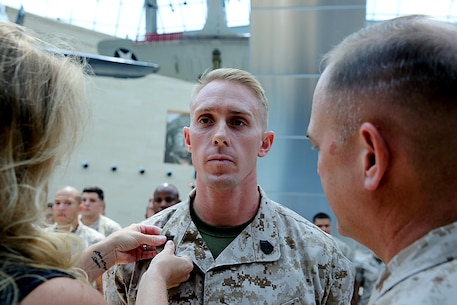 Justin R. Gates with Chemical Biological Incident Force, CBIRF, was pinned to the rank of gunnery sergeant by his wife and Col. Stephen E. Redifer during a promotion/reenlistment ceremony at the National Museum of the Marine Corps at Triangle, Va., Aug. 1, 2016. Gates works as a ground electrician system maintenance mechanic and runs the Marine Corps Martial Arts Program, MCMAP, for CBIRF. (Official USMC photo by Lance Cpl. Maverick Mejia)