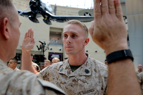 Justin R. Gates with Chemical Biological Incident Force, CBIRF, recites the reenlistment oath given by Col. Stephen E. Redifer during a promotion/ reenlistment ceremony at the National Museum of the Marine Corps, Triangle, Va., Aug. 1, 2016. Gates works as a ground electrician system maintenance mechanic and runs the Marine Corps Martial Arts Program, MCMAP, for CBIRF. (Official USMC photo by Lance Cpl. Maverick Mejia)