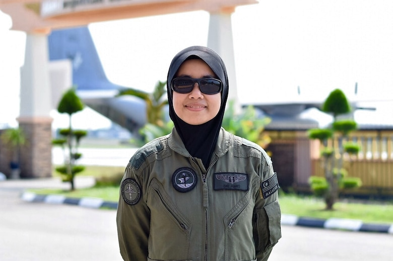 Lt. Col. (Dr.) Amei Farina Bt Abd Rashid, Chief Instructor/Aviation Medicine Specialist, Royal Malaysian Air Force, stops for a photo during the Asia Pacific Military Health Exchange 2016 in Kuantan, Malaysia, Aug. 3, 2016. Co-hosted by U.S. Pacific Command surgeon and the Malaysian Armed Forces Health Services Division, the Asia Pacific Military Health Exchange (AMPHE) 2016 included plenary sessions focused on a variety of medical professions, as well as breakout sessions specific to ground, air, and maritime forces in the Indo-Asia- Pacific region. APMHE 16 takes place from Aug 1-5, 2016 and involves nearly 500 participants from 27 different countries focused on global health interoperability. (Department of Defense Photo by Master Sgt. Todd Kabalan)