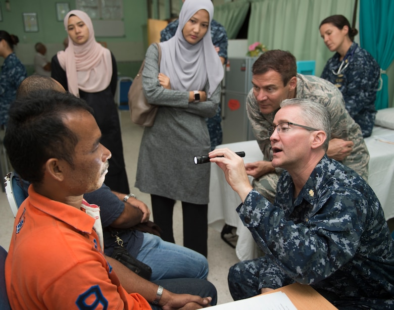 U.S. Navy Capt. Craig Salt (right), from Annapolis, Maryland, and U.S. Air Force Lt. Col. Jeff Healy, from Honolulu, both plastic surgeons assigned to USNS Mercy (T-AH 19), examine a patient during a Pacific Partnership 2016 surgical screening at the Kuantan Naval Base medical facility. This is the first time Pacific Partnership has visited Malaysia. Partner nations are working side-by-side with local organizations in a search-and-rescue exercise, civil engineering projects, community relation events and subject matter expert exchanges. (U.S. Navy photo by Mass Communication Specialist 2nd Class Lindsey E. Skelton/Released)