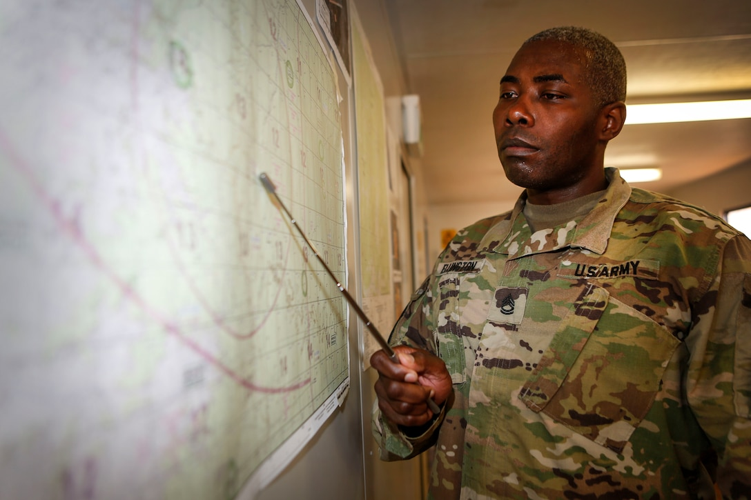 U.S. Army Sgt. 1st Class Jermaine R. Ellington, assigned to the 5th Battlefield Coordination Detachment, gives a mission brief during Exercise Pitch Black 2016. Pitch Black is a biennial multinational air warfare exercise hosted by the Royal Australian Air Force (RAAF) that focuses on offensive counter air and defensive counter air combat in a simulated war environment. (Australian Defence Force photo by Cpl. Casey Gaul)