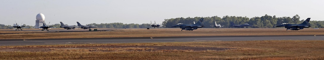 Royal Australian Air Force (RAAF) FA-18A Hornets, U.S. Air Force and Indonesian Air Force F-16s, and Republic of Singapore Air Force F-15s, prepare to take off for a morning sortie during Exercise Pitch Black, at RAAF Base Darwin, Australia, Aug. 2, 2016. Pitch Black is a biennial multinational air warfare exercise hosted by the RAAF that focuses on offensive counter air and defensive counter air combat in a simulated war environment. (Australian Defence Force photo by LSIS Jayson Tufrey)