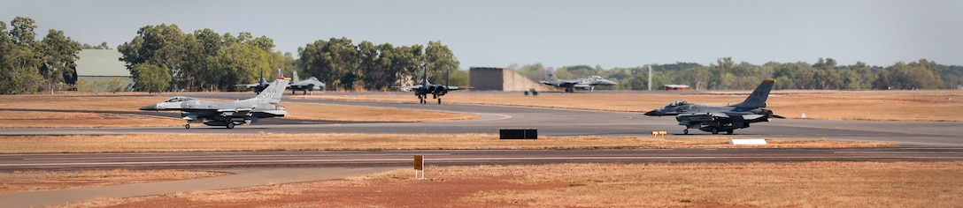 A U.S. Air Force F-16C aircraft and Republic of Singapore Air Force F-15 Eagle aircraft taxi during exercise PITCH BLACK 16 (PB16) at Royal Australian Air Force (RAAF) Base Darwin, Australia, Aug. 1, 2016. PB16 allows participant nations to exercise deployed units in the tasking, planning and execution of Offensive Counter Air and Offensive Air Support while utilizing one of the largest training airspace areas in the world.  The exercise is scheduled from July 29 to Aug.19, 2016. (Australian Defence Force photo by Cpl. Casey Gaul)