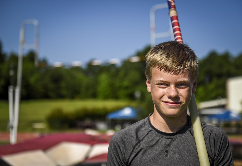 Andrew Bronson, 14, son of 628th Air Base Wing Command Chief Master Sgt. Mark A. Bronson, poses for a photo during pole vaulting practice at the Park West Recreation Center in Mt. Pleasant, S.C., July 20, 2016. Bronson was preparing to compete in the USA Track and Field National Junior Olympics which took place in Sacramento, Calif., July 25-31, 2016. (U.S. Air Force photo by Staff Sgt. Marianique Santos/Released)