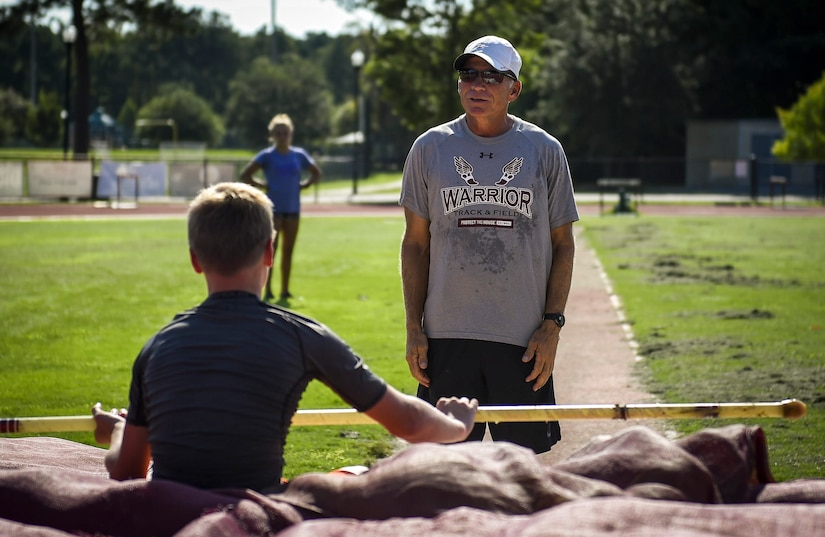 Pole vault Coach Tom Reagan, gives Andrew Bronson, son of 628th Air Base Wing Command Chief Master Sgt. Mark A. Bronson, feedback on his performance at the Park West Recreation Center in Mt. Pleasant, S.C., July 20, 2016. Bronson was preparing to compete in the USA Track and Field National Junior Olympics which took place in Sacramento, Calif., July 25-31 2016. (U.S. Air Force photo by Staff Sgt. Marianique Santos/Released)