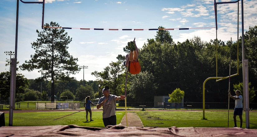 Andrew Bronson, 14, son of 628th Air Base Wing Command Chief Master Sgt. Mark A. Bronson, launches himself into the air during pole vaulting practice at the Park West Recreation Center in Mt. Pleasant, S.C., July 20, 2016. Bronson practiced prior to competing in the USA Track and Field National Junior Olympics which took place in Sacramento, Calif., July 25-31, 2016. (U.S. Air Force photo by Staff Sgt. Marianique Santos/Released)