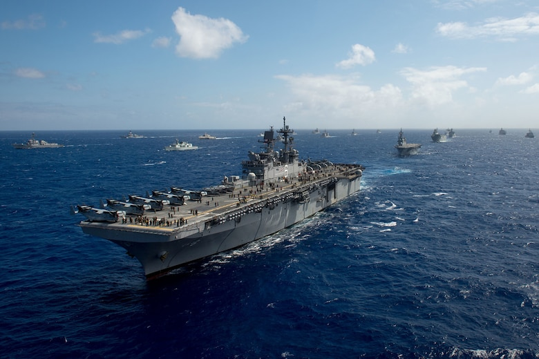 The amphibious assault ship USS America (LHA 6), one of 40 ships and submarines representing 12 international partner nations, steams along during a group sail as part of exercise Rim of the Pacific 2016. Twenty-six nations, more than 40 ships and submarines, more than 200 aircraft, and 25,000 personnel are participating in RIMPAC from June 30 to Aug. 4, in and around the Hawaiian Islands and Southern California. The world's largest international maritime exercise, RIMPAC provides a unique training opportunity that helps participants foster and sustain the cooperative relationships that are critical to ensuring the safety of sea lanes and security on the world's oceans. RIMPAC 2016 is the 25th exercise in the series that began in 1971.