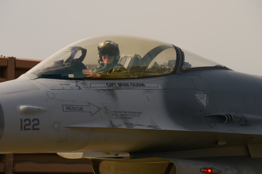 Col. Brian Carr, 51st Fighter Wing vice commander, poses for a photo following his final flight in an F-16 Fighting Falcon at Osan Air Base, Republic of Korea, Aug. 4, 2016. Carr has served as the fighter wing's vice commander since August 2014. (U.S. Air Force photo by Senior Airman Dillian Bamman)