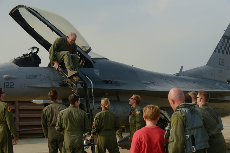 Col. Brian Carr, 51st Fighter Wing vice commander, exits an F-16 Fighting Falcon following his final flight at Osan Air Base, Republic of Korea, Aug. 4, 2016. Carr will be retiring after more than 23 years of service to the Air Force, with three years spent assisting in the defense of the Korean Peninsula. (U.S. Air Force photo by Senior Airman Dillian Bamman)