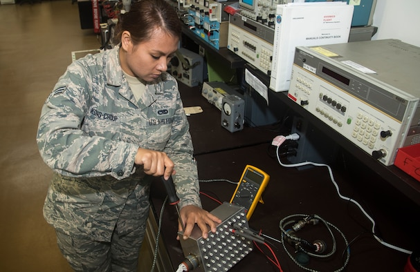 U.S. Air Force Senior Airman Nary Kong-Choup, a team member with the 35th Maintenance Squadron avionics intermediate section electronic warfare section, assembles a breakout box at Misawa Air Base, Japan, Aug. 1, 2016. Kong-Choup was one of seven Airmen who took the initiative on building this device, saving time and requiring less manpower to operate. The apparatus connects to parts on F-16 Fighting Falcons, called line replacement units, and inspects the integrity of electrical pathways. (U.S. Air Force photo by Senior Airman Jordyn Fetter)