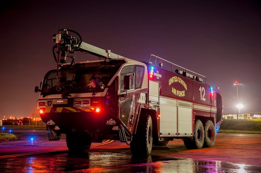 An 18th Civil Engineer Squadron Oshkosh Striker fire truck stands ready during a hot refueling exercise July 27, 2016, at Kadena Air Force Base, Japan. With a top speed of 70-mph and an engine capable of 1,950 foot-pounds of torque at 1,400 rpm, fire suppression teams can respond immediately to emergencies anywhere on the flight line. (U.S. Air Force photo by Senior Airman Peter Reft)