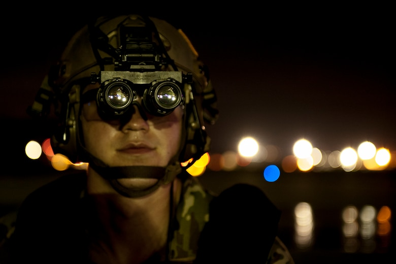 Senior Airman Brandon Craver, 18th Logistics Readiness Squadron fuels distribution operator, observes the flight line during a nighttime refueling exercise July 27, 2016, at Kadena Air Base, Japan. The 18th LRS and 1st Special Operations Squadron conducted a refueling exercise to demonstrate forward-area refueling point capability in an austere environment. (U.S. Air Force photo by Senior Airman Peter Reft)