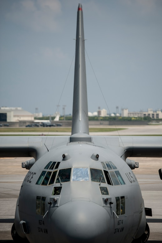 A U.S. Air Force C-130H Hercules assigned to Yokota Air Base parks at a refueling point July 28, 2016, at Kadena Air Base, Japan. Kadena is the keystone of the Pacific and supports air operations from all branches of service. (U.S. Air Force photo by Senior Airman Peter Reft/Released)